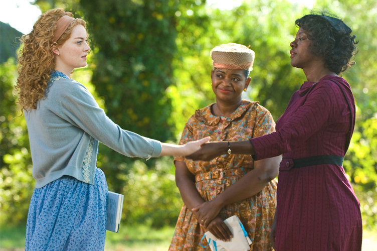 Skeeter (Emma Stone) teams up with Minny (Octavia Spencer) and Aibileen (Viola Davis).